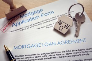 Stamped and Approved Forms of Mortgage Application Along With the House Key