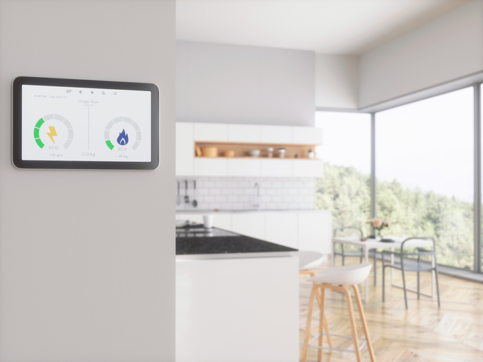 Home energy smart meter displayed in the kitchen to help control energy bills